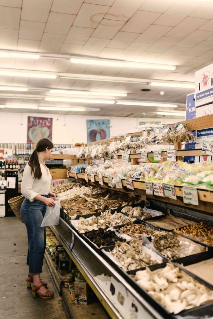 shopping for groceries in the mushroom aisle of the grocery store