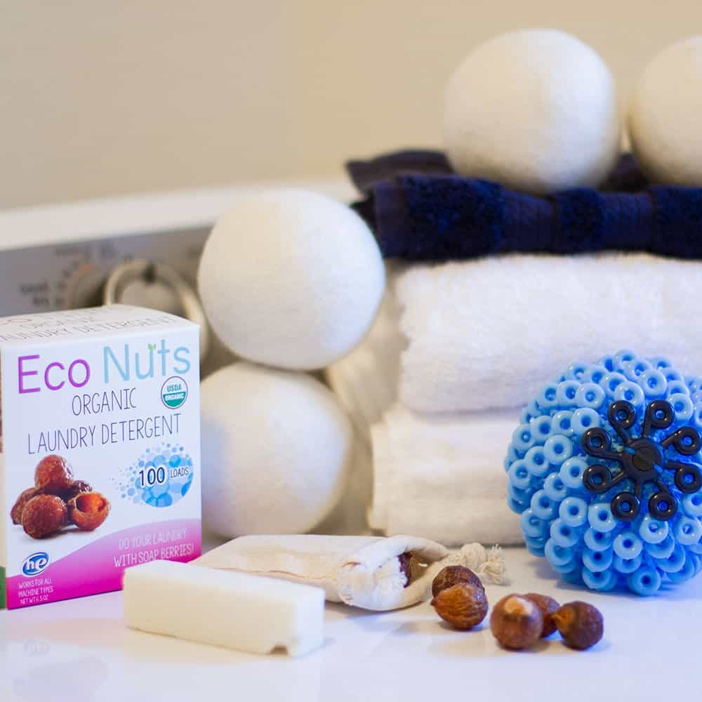earth hero laundry basket including a cora ball, soapnuts, towels, and wool dryer balls | organic, all natural, eco friendly