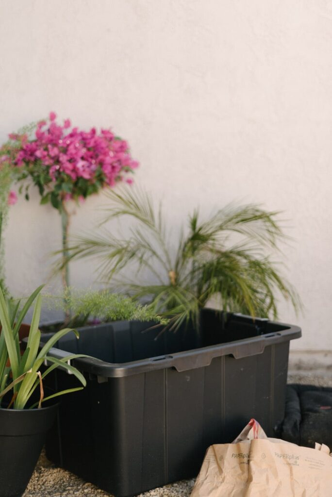 a DIY compost bin made from a plastic bin