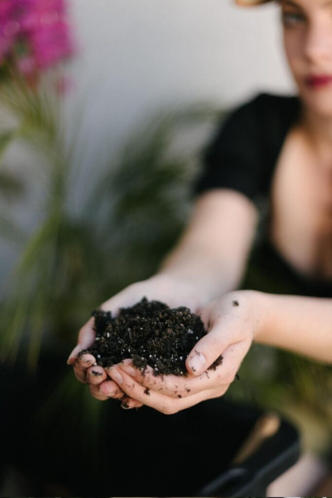 girl holding compost